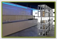 industrial sized kitchen with blue lighting